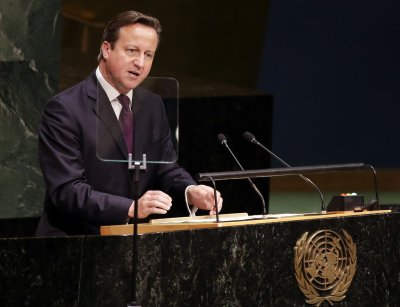 Russia must adhere to Ukraine peace plan, Cameron says