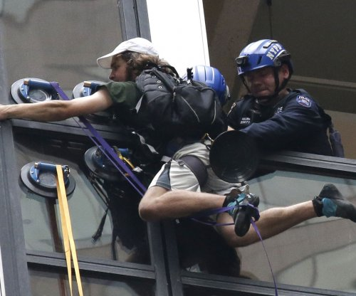 Virginia man who climbed Trump Tower with suction cups faces criminal charges
