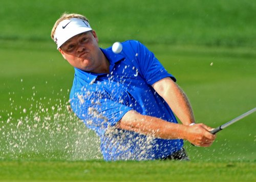 Singh, Woods, Pettersson share PGA lead