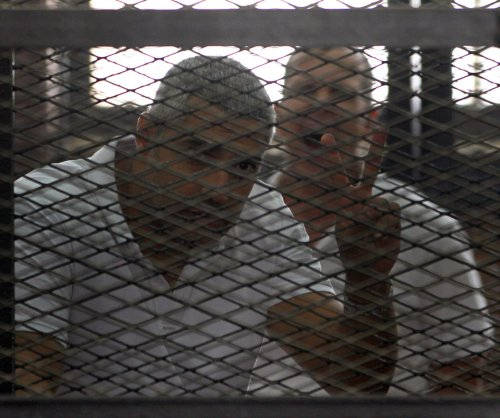 Al-Jazeera journalists released from prison pending retrial