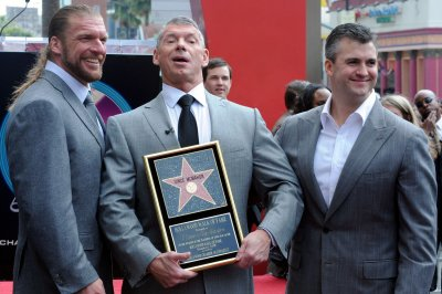 More than 50 retired wrestlers sue WWE over brain injuries