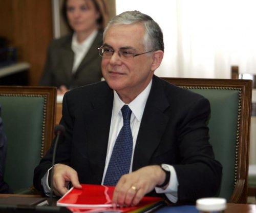 Ex-Greek PM Papademos injured by mail bomb in Athens