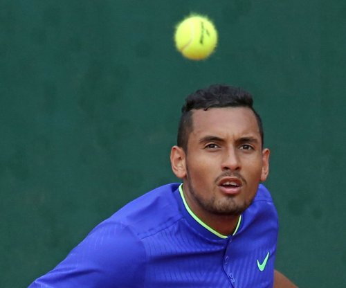 Tennis star Nick Kyrgios fined for lewd gesture with water bottle