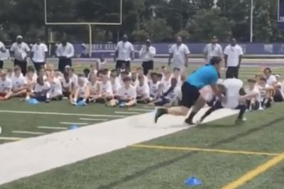 Panthers' Luke Kuechly clobbers kid with tackle at camp