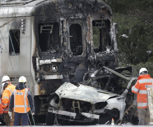 Commuter train hits SUV near NYC killing 7, injuring 12