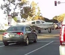 Dashcam records plane landing on busy California street