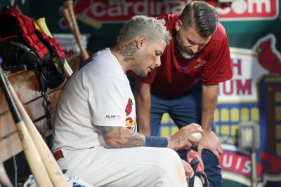 St. Louis Cardinals place All-Star catcher Yadier Molina on IL due to thumb injury