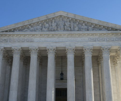 Juveniles given life in prison can seek review, possibly parole, Supreme Court rules