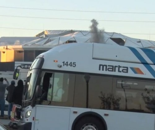 Bus spoils cameraman's view of Georgia Dome implosion
