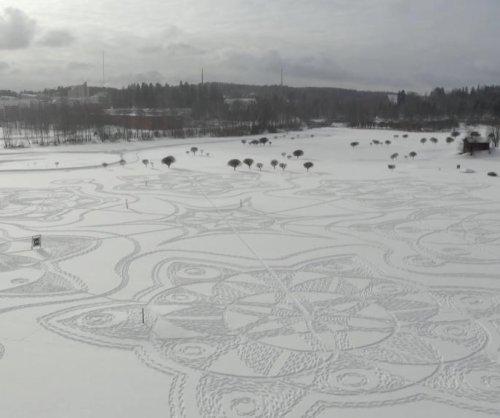 Finnish artist recruits snowshoers for golf course art