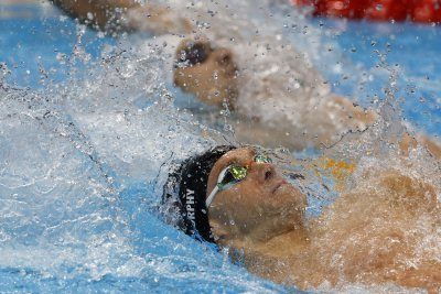 Swimmers help USA keep medal lead, others miss Olympic podium in track, BMX