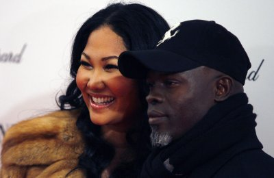 Hounsou and Simmons break up