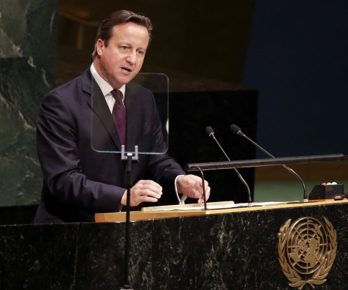 Britain's Cameron gets tough on immigration