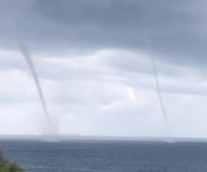 Hawaii resident captures video of double waterspouts