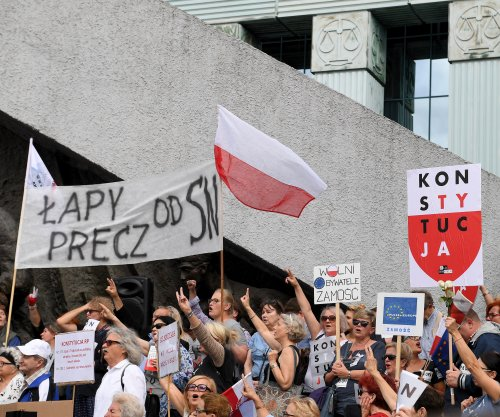 Protesters rally around Polish Supreme Court justice in defiance of new law