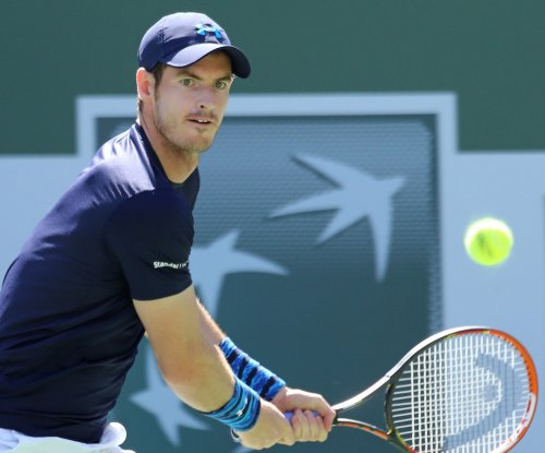 Murray moves on in Miami