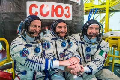 Astronauts arrive at space station aboard Soyuz on 50th anniversary of moon
