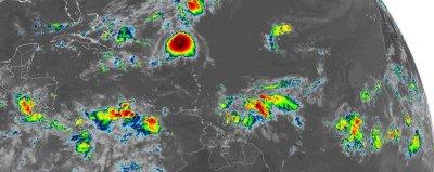 Jerry weakens into tropical storm, passes north of Leeward Islands