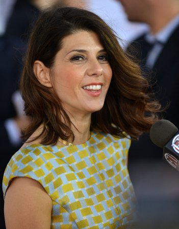 Marisa Tomei cozies up to Daniel Radcliffe on the set of new film