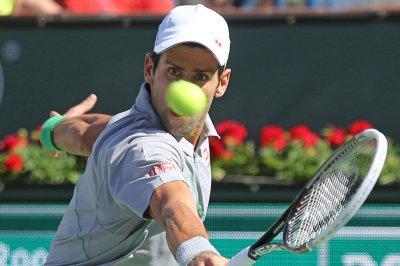 Djokovic, Wawrinka win Aussie openers