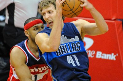 Mavericks handle short-handed Wizards