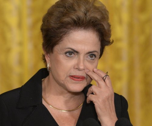 Brazil Senate votes for impeachment trial; Rousseff says she's a 'victim of great injustice'