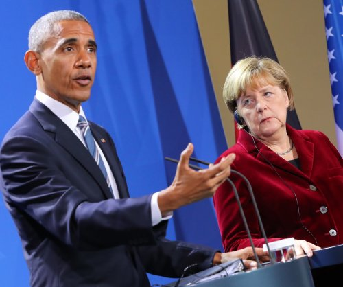 Obama, Merkel rebuke Trump proposals, potential 'meaner' world