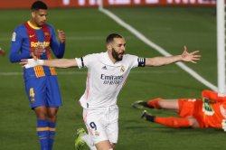 Real Madrid holds off Barcelona, Lionel Messi in El Clasico soccer rivalry