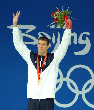 Phelps completes perfect Olympics