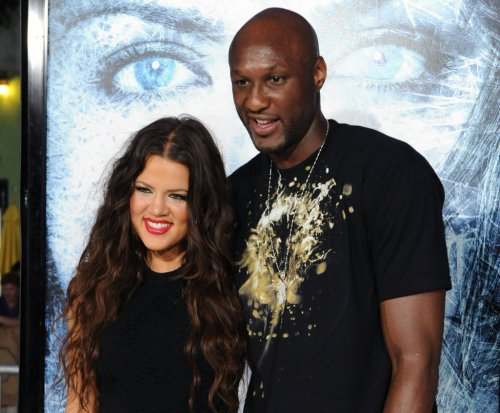 Khloe Kardashian says Lamar Odom is improving