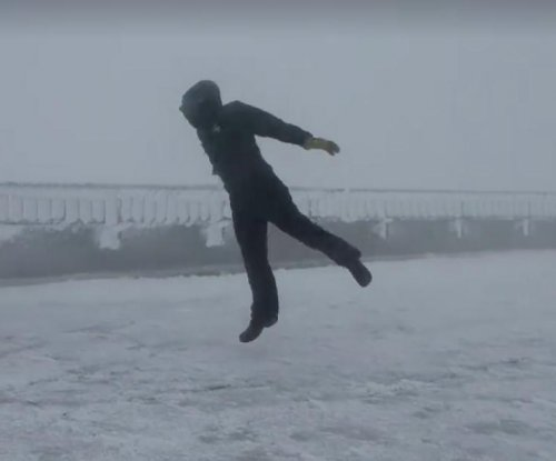 Weather observer attempts to stand in 100 mph winds
