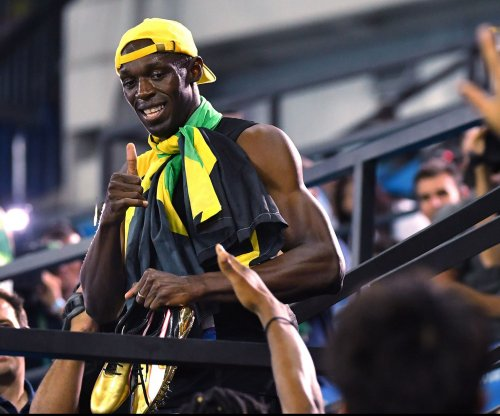 Usain Bolt arrives in Range Rover, wins final race in Jamaica