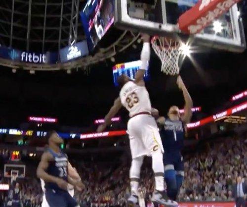 Cavaliers' LeBron James blocks Timberwolves' Tyus Jones into next week