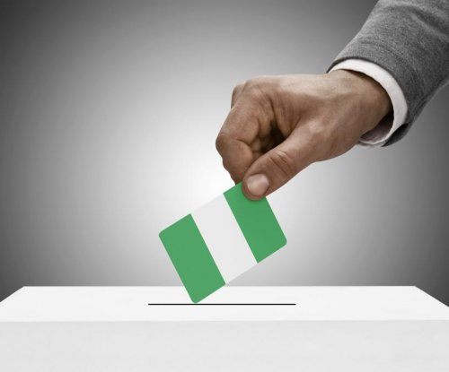 Nigerian official confident of postponed election success, opposition candidate critical