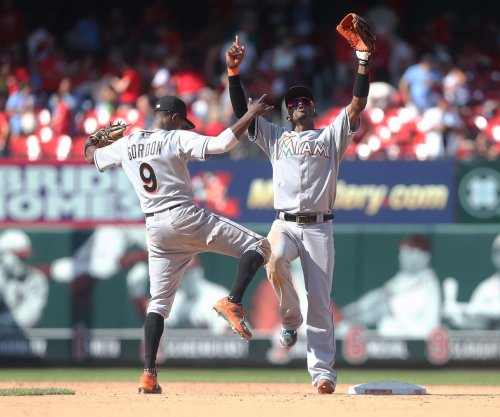 Dee Gordon, Miami Marlins speed past Philadelphia Phillies in 11th inning