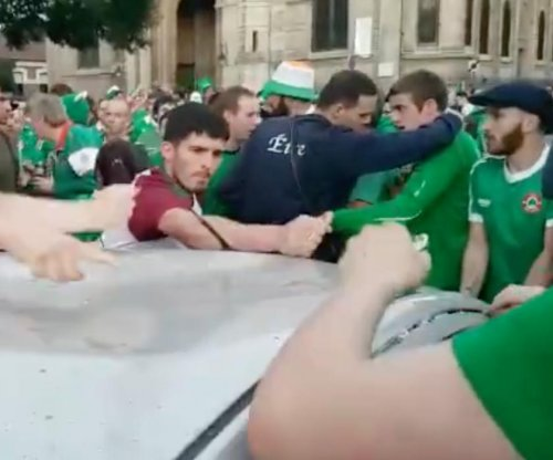 Irish soccer fans dent car roof, immediately fix it