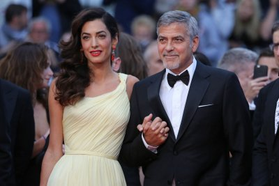 George Clooney vows to sue over paparazzi photos of twins