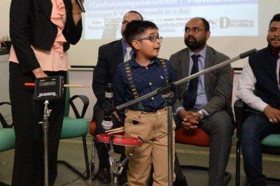 Six-year-old boy breaks speed drumming world record