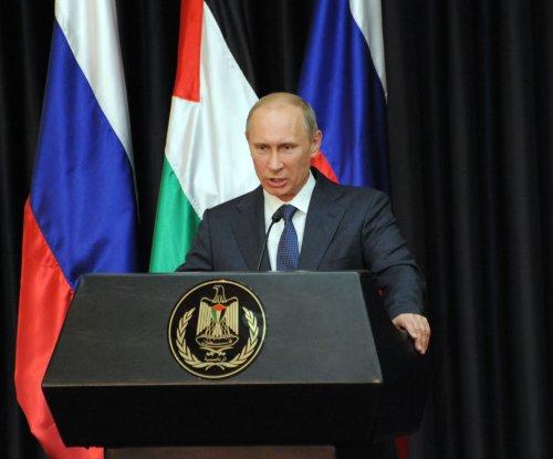 Putin awards murder suspect, Chechen leader in ceremony