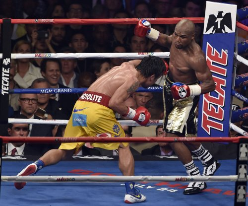 Winner Mayweather says no rematch for 'sore loser' Pacquiao
