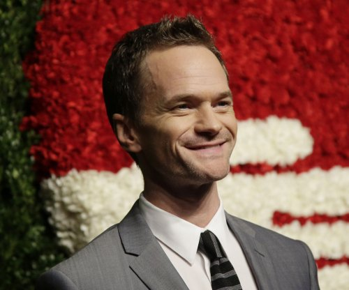 Neil Patrick Harris reads the first Christmas story to Epcot crowd