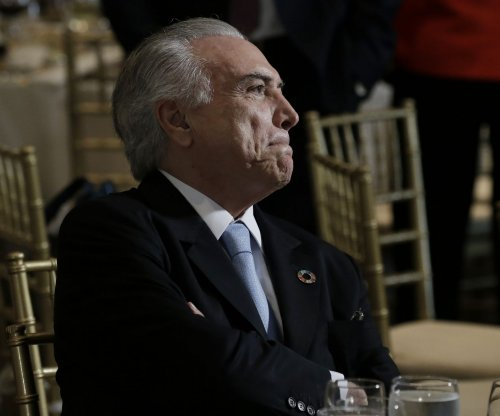 Brazilian President Temer survives vote on corruption trial