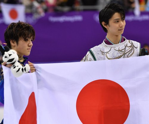 Hanyu wins men's figure skating title for Japan's first gold medal