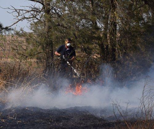 Israelis battle blazes started by flaming kites on Gaza border