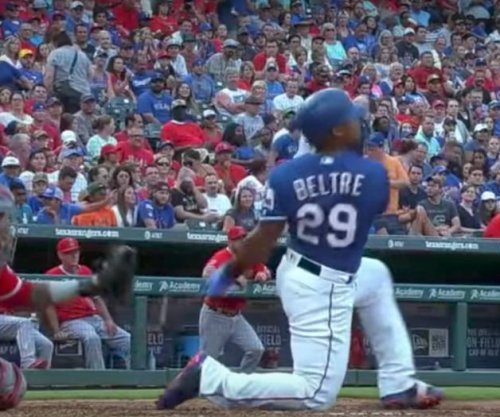 Texas Rangers slugger Adrian Beltre hits home run off of knee