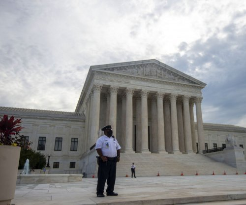 Biden's Supreme Court reform panel sheds two conservative members