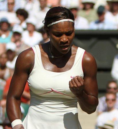 Williams sisters reach Wimbledon quarters