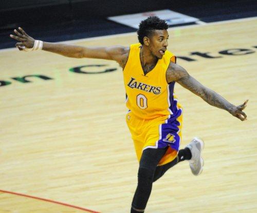 Ellington rallies Los Angeles Lakers over Milwaukee Bucks