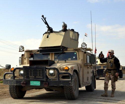 Iraqi army retakes two neighborhoods in western Mosul