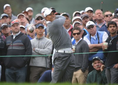 Thompson leads, Woods threatens at Open